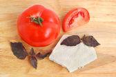 Cheese, tomato and basil — Stock Photo
