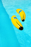 Banana in swimming pool — Stock Photo