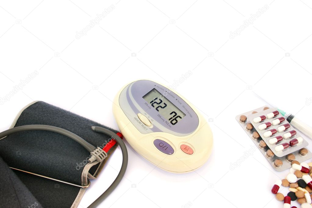 Modern digital blood pressure measurement and pills, tablets  isolated on white background. — Foto Stock #5661087