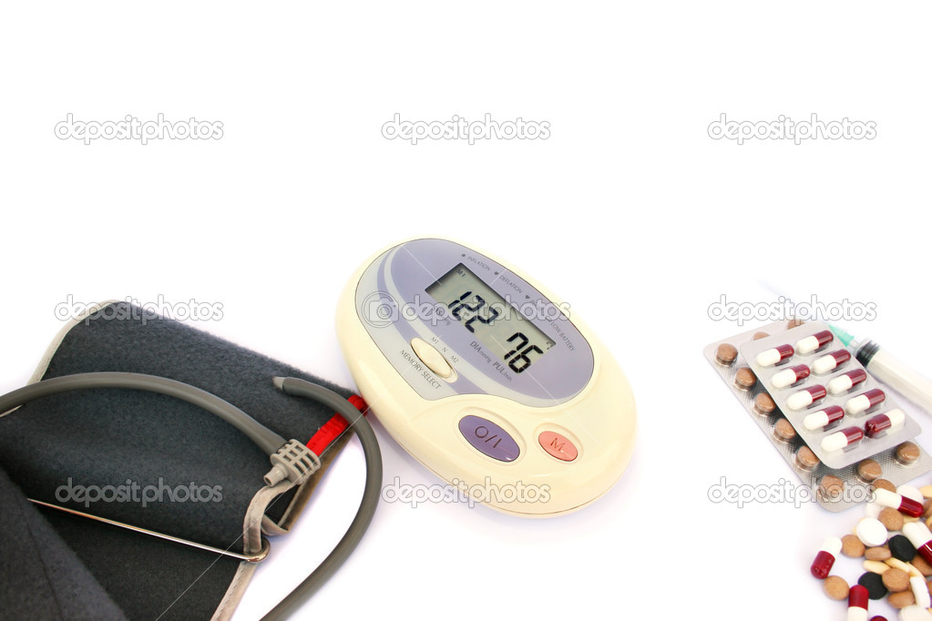 Modern digital blood pressure measurement and pills, tablets  isolated on white background. — Foto de Stock   #5661087
