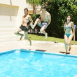Jumping to swimming pool — Stock Photo