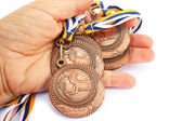 Medals in hand — Stock Photo
