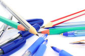 Pens and pencils on white — Stock Photo
