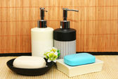 Soap dispensers and bars — Stock Photo