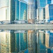 Business skyscrapers and reflections in the river — Stock Photo