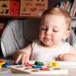 Boy and colorful toy blocks — Stock fotografie
