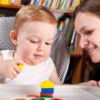 Mother playing with her son in blocks — Stock Photo #6012600