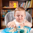 Stock Photo: Little boy investigating pasta