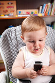 Little boy writing sms — Stock Photo