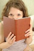 Hiding over book — Stock Photo