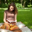 Pretty girl is reading book — Stockfoto