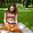 Pretty girl is reading book — Foto Stock
