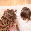 Two girls on the floor — Stock Photo