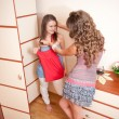 Two young girls choosing dress — Stock Photo