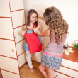Stock Photo: Two young girls choosing dress