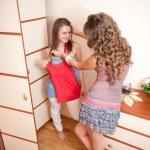 Two young girls choosing dress — Stock Photo
