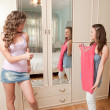 Foto Stock: Two girls choosing dress