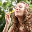 Young girl blowing bubbles — Stock Photo #6449325