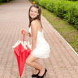 Young girl with umbrella in park — Stock Photo #6449464