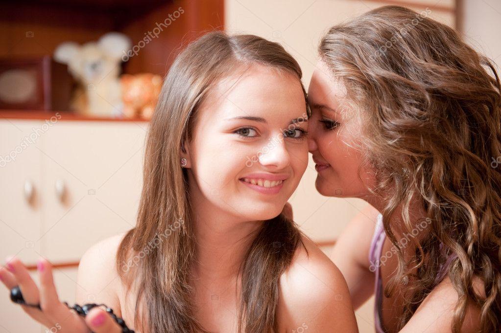 Two girls rumoring - stock image