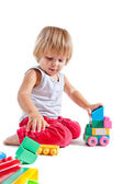 Cute little boy playing with toys — Stock Photo