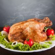 Delicious roast chicken with red tomatoes and green salad — Stock Photo