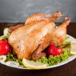 Roast chicken with fresh vegetables - Stock Photo