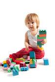 Rolig pojke leker med block — Stockfoto