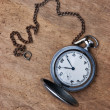 Old pocket watch on wooden background — Stock Photo #5404267