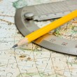 Pencil and protractor on map — Stock Photo #5405777