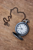 Old pocket watch on wooden background — Stock Photo