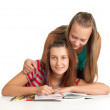 Two teenage girls smiling and reading book — Stock Photo #5411818