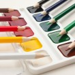Color pencils and watercolor paints - Stock Photo