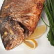 Dish of fried fish with onions — Stock Photo #5417751
