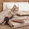 Постер, плакат: Pile parcel wrapped with brown kraft paper