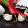 Royalty-Free Stock Photo: Notebook for cooking recipes and vegetables