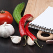 Notebook for cooking recipes and vegetables — Stock Photo #5418540