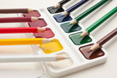 Color pencils and watercolor paints — Stock Photo