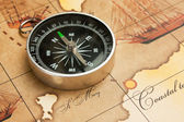 Compass on map — 图库照片