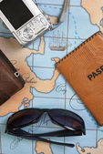 Passport and sunglasses on map — Stok fotoğraf