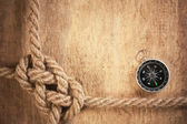 Compass and rope knot — Stock Photo