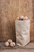 Walnuts in a kraft paper bag — Stock Photo