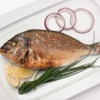 Dish of fried fish with onions - Foto Stock