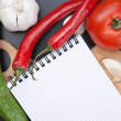 Notebook for cooking recipes and vegetables — Stock Photo