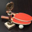Stock Photo: Sports award and tennis racquets