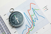 Compass and paper work — Stock Photo