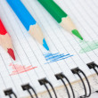 Red, green, and blue pencil on notepad — Stock Photo #5458709