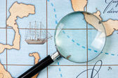 Magnifier on map — Stock Photo