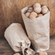Walnuts in kraft paper bag — Stock Photo #5471821