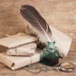 Letter and a quill in the inkwell — Stock Photo